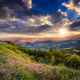 Village between in mountain at sunset Stock Image