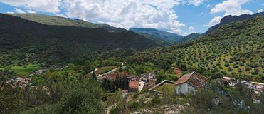 Village in mountain valley in Andalusia, Spain Stock Photo
