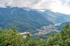 Village in a mountain valley among the green forest stock photos