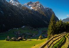 Village in mountain valley. Village in the mountain valley under the blue sky royalty free stock images