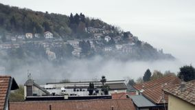 Village in the mountains above the clouds stock video