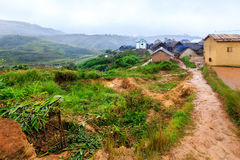 Village in the mountains of Africa on a misty rainy morning Stock Photo