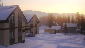 Village in the mountains at amazing sunrise. Fantastic winter landscape. Snowy mountains. Fantastic winter landscape. Snowy mountains. Village in the mountains Royalty Free Stock Photography