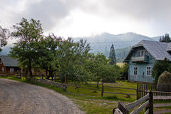 The village in the mountains. Village in the mountains in the morning haze Stock Photo