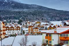 Village mountains snow. Village in the mountains with snow royalty free stock photos