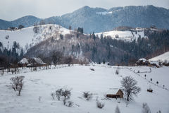 A village in the mountains. A village spread out over the mountains of Romania, in the winter Royalty Free Stock Photography