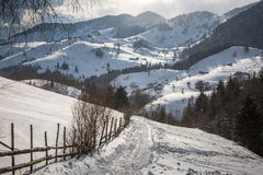A village in the mountains. A village spread out over the mountains of Romania, in the winter Royalty Free Stock Images