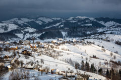A village in the mountains. A village spread out over the mountains of Romania, in the winter Royalty Free Stock Photo