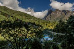 Village in mt.everest trekking route with beautiful view of moun stock photos