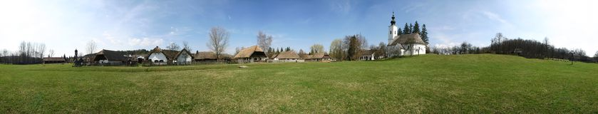 Village museum panorama. Old rural houses in an outdoor village museum, in Szenna, Hungary, Europe Stock Photography