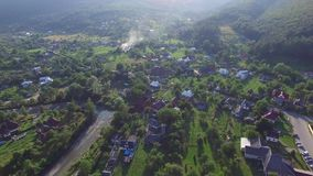 Village near forest aerial circular view stock footage