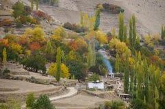 Village near Hoper Glacier in autumn, Pakistan Stock Photos