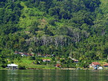 The village near Lake Toba. Small village by the lake. Taken in Lake Toba, the biggest volcano eruption lake in the world, location in North Sumatra, Indonesia Royalty Free Stock Photos