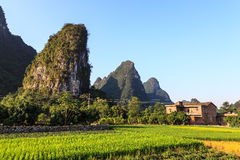 Village near limestone rock formations in South China Royalty Free Stock Images