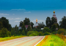 A village near Moscow. Road passing through a suburban village in the background where you can see the Church and dome Stock Photography