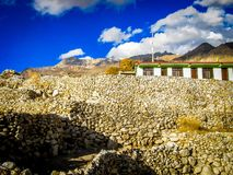 A village near Nako, Himachal Pradesh. Beautiful clouds over the rocky walls and streets of a village near Nako, Himachal Pradesh Royalty Free Stock Image