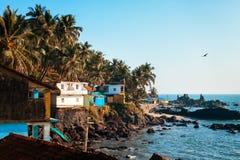 Village near rocks in ocean Stock Images