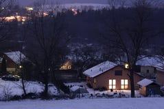 Village at night. View of night village in winter season Stock Photos