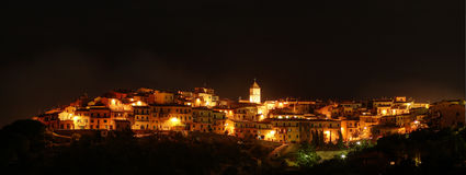 Village at night Stock Images