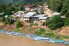Idyllic Village Nong Khiaw with vessels at the river, Laos Royalty Free Stock Image