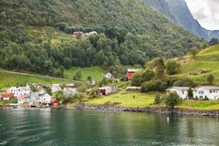Village in Norway. Landscape with Naeroyfjord, mountains and traditional village houses in Norway Royalty Free Stock Photography