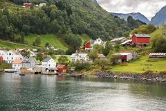 Village in Norway. Landscape with Naeroyfjord, mountains and traditional village houses in Norway Royalty Free Stock Images