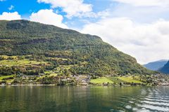 Village in Norway. Landscape with Naeroyfjord, mountains and traditional village houses in Norway Royalty Free Stock Photos