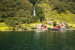 Village in Norway. Landscape with Naeroyfjord, waterfall, mountains and traditional village houses in Norway Royalty Free Stock Photo