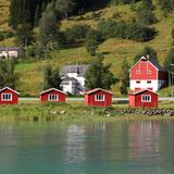 Village in Norway. Norway, Sogn of Fjordane county. Small red cabins next to Nordfjord in Olden. Square composition Stock Images