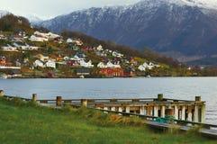 Village at the norwegian fjord. Family houses on the norwegian fjord coastline on the sunrise. Rosendal, Kvinnherad, Norway Stock Photo