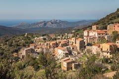 Village of Novella in Balagne region of Corsica. Mountain village of Novella in the Balagne region of Corsica with the Desert des Agriates and Mediterranean sea royalty free stock image