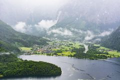 Village Obertraun in Austria. Rain and clouds on the Obertraun in Austria. Morning mist over the Austrian landscape with lake Hallstattersee, forests, fields stock image