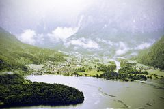 Village Obertraun in Austria. Rain and clouds on the Obertraun in Austria. Morning mist over the Austrian landscape with lake Hallstattersee, forests, fields royalty free stock images