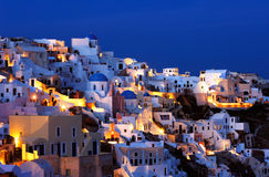 The village of Oia at dusk. Image shows the village of Oia at dusk, on the beautiful island of Santorini, Greece Royalty Free Stock Photo