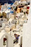 The village of Oia on Santorini with colorful iconic buildings and spectacular views. The very iconic town of Oia on Santorini with its whitewashed homes, blue stock images