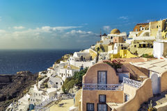 Village of Oia with white cave homes on Santorini Stock Photos