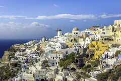 Village of Oia with white cave homes on Santorini Island Stock Image