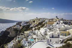 Village of Oia with white cave homes on Santorini Island Royalty Free Stock Photos