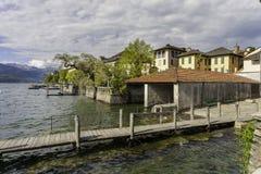 Village of Orta and the Island of San Giulio on Lake Orta, Italy Stock Photo
