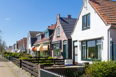 Village Oudeschild on Texel island in the Netherlands. Village Oudeschild with a row of trraditional fisherman houses on Texel island in the Netherlands Stock Images