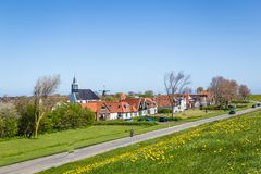 Village Oudeschild on Texel island in the Netherlands. Panorama Village Oudeschild with Martinus church, windmill and trraditional gable houses on the Wadden stock photos