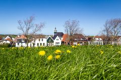 Village Oudeschild on Texel island in the Netherlands. Panorama Village Oudeschild with Zeemans church and trraditional gable houses on the Wadden island Texel royalty free stock images