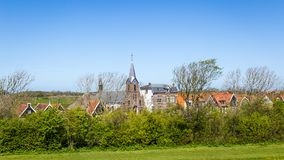 Village Oudeschild on Texel island in the Netherlands. Village Oudeschild with Martinus church and trraditional gable houses on the Wadden island Texel in the stock photography