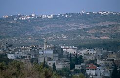 A village in Palestine and an Israeli settlement. Stock Photo
