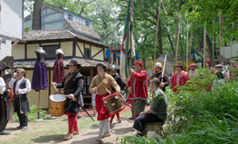 Village Parade. Period actors reenact a formal military procession through a Renaissance festival, drummers followed by musketeers and spear men Stock Photos
