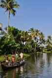 Village people carrying rocks in a boat, Kerala India.