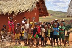 Village people in Madagascar. Traditional village in Madagascar, people gathered under the sun Stock Photo