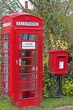 Village Phonebox & Postbox. A traditional Englush village postbox and phonebox with a modern twist with a credit card only phonebox and a sign of vandalism Stock Image