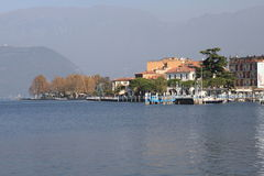 Village and pier at Lake Iseo Royalty Free Stock Photography
