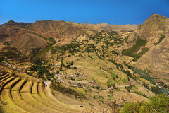 Village of Pisac and inca agricultural terraces. Cusco, Peru Stock Images